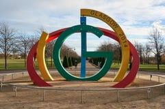 Статуя искусства расположенная в популярном парке зеленого цвета Глазго для того чтобы отпраздновать игры государства Глазго успе стоковое изображение