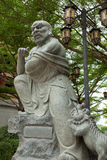 Статуя мастера Kungfu с львом стоковые фото