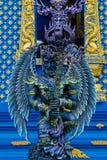 Статуя предохранителя ангела в голубом виске Chiang Rai, Таиланде Стоковое Фото