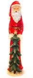 Статуя Санта Клауса с предпосылкой рождественской елки белой ясной Стоковые Изображения