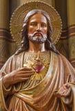 Статуя сердца Антверпена - Иисуса от Joriskerk или церков St. George стоковое фото rf
