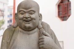 Статуя Maitreya-Eighteen досточтимая каменная высекать-большая Стоковая Фотография RF