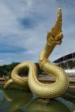 Статуя Naga на воде Стоковое фото RF