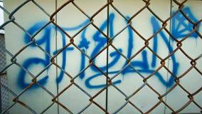 Стальная сетка перед графической стеной Стоковая Фотография