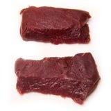 Стейки мяса верблюда изолированные на белизне Стоковое фото RF