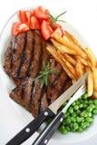 стейк зажженный обедом Стоковая Фотография RF