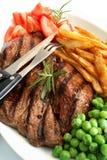 стейк зажженный обедом Стоковые Изображения RF