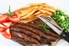 стейк зажженный обедом Стоковые Фото