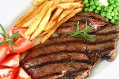 стейк зажженный обедом Стоковые Изображения