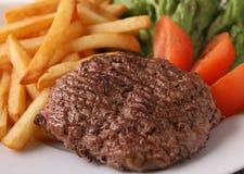 Стейк и fries Стоковые Изображения