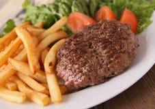 Стейк и fries Стоковые Изображения RF