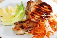стейк свинины плиты Стоковые Фотографии RF