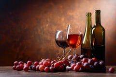 Стекла и бутылки вина Стоковые Фото