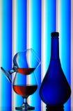 стекла конгяка бутылки стоковая фотография