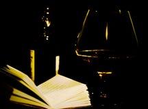 Стекло, бутылка и книга стоковое фото rf