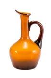 Стекло желтого коричневого цвета вазы кувшина изолированное на белизне Стоковые Фото