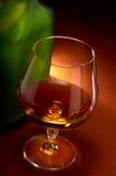 стекло конгяка бутылки Стоковые Изображения