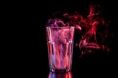 Стекло с красочным дымом стоковые фотографии rf