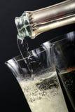 стекло шампанского политое к Стоковые Изображения