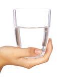 стеклянная вода удерживания руки Стоковые Изображения RF