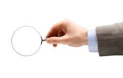 стеклянной увеличивать изолированный рукой Стоковое фото RF