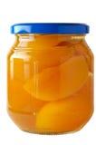 стеклянные сохраненные персики опарника Стоковая Фотография