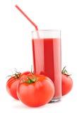 стеклянные томаты томата сторновки сока Стоковые Фотографии RF