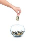 Стеклянный банк для подсказок при изолированные деньги и рука стоковая фотография rf