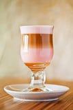 стеклянный сироп macchiato latte grenadine стоковое изображение