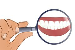 стеклянный увеличивая зуб вниз Стоковая Фотография