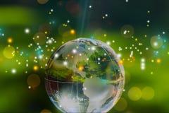 Стеклянный шарик глобуса в световых лучах на предпосылке Стоковое Изображение