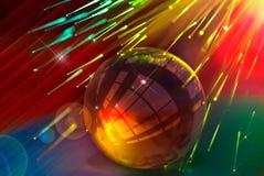Стеклянный шарик против предпосылки оптического волокна Стоковое Фото