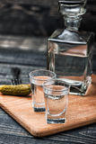 Стекла водочки на деревянном столе Стоковое Фото