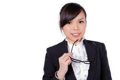 Стекла женщины нося держа рамку Стоковые Изображения