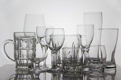 Стекла питья на белой предпосылке Стоковые Изображения