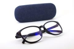 стекла с голубыми джинсами Стоковые Фотографии RF