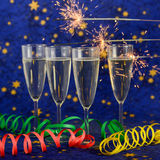 Стекла с шампанским против светов праздника Стоковое Фото