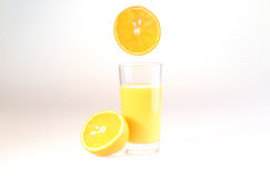 Стекло апельсинового сока на белой предпосылке Стоковое Фото