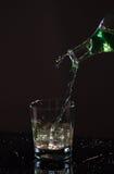 Стекло воды на черной предпосылке Стоковая Фотография