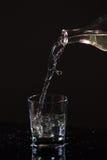 Стекло воды на черной предпосылке Стоковая Фотография RF