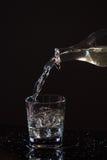 Стекло воды на черной предпосылке Стоковые Фото