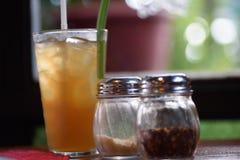 Стекло питья на таблице Стоковая Фотография