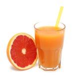 Стекло свеже отжатого изолированного сока грейпфрута Стоковое фото RF