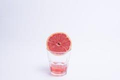 Стекло сока розового грейпфрута над белой предпосылкой Стоковое Фото