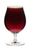 Стекло тюльпана темного изолированного пива эля Стоковые Изображения