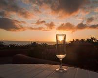 Стекло чисто воды на заходе солнца Стоковое Изображение