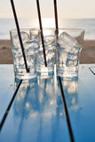 Стекло льда на таблице на лете захода солнца стоковые фото