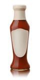 Стеклянная бутылка горячего томатного соуса стоковое изображение rf