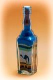 Стеклянная бутылка с декоративным песком Стоковые Фото