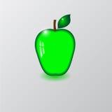 Стеклянное зеленое яблоко Стоковые Фото